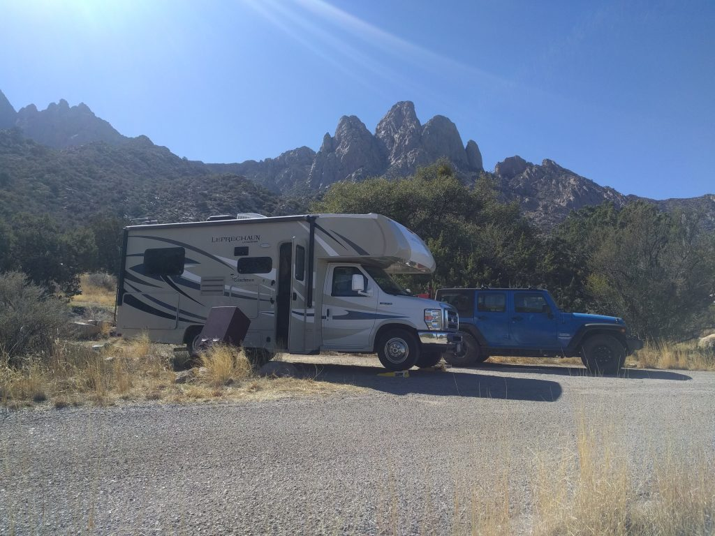 Our Leprechaun RV parked next to our Jeep Wrangler in Aguirre Springs campground near Las Cruces New Mexico.