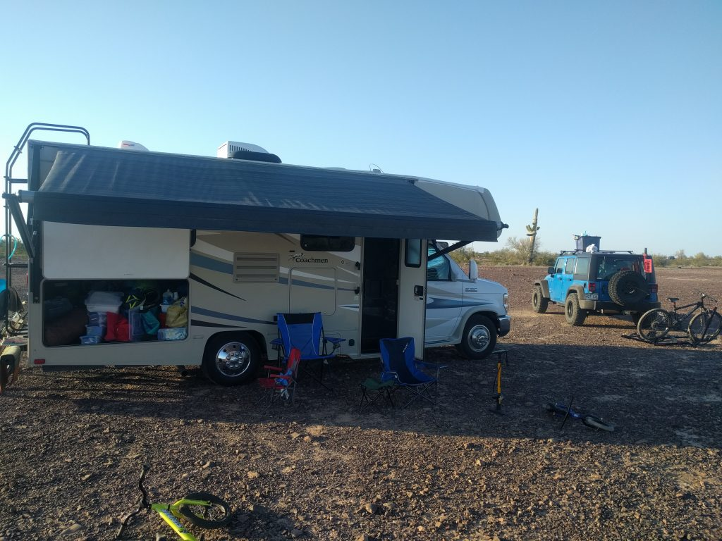 Coachmen Leprechaun 21QB boondocking at Quartzite Arizona with awning out and basement door open.